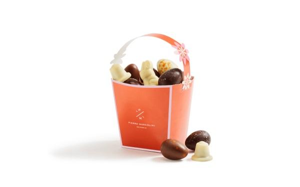 Шоколад PIERRE MARCOLINI, КОРЗИНКА оранжевая - ассорти 12 яиц + 4 животных, 146г