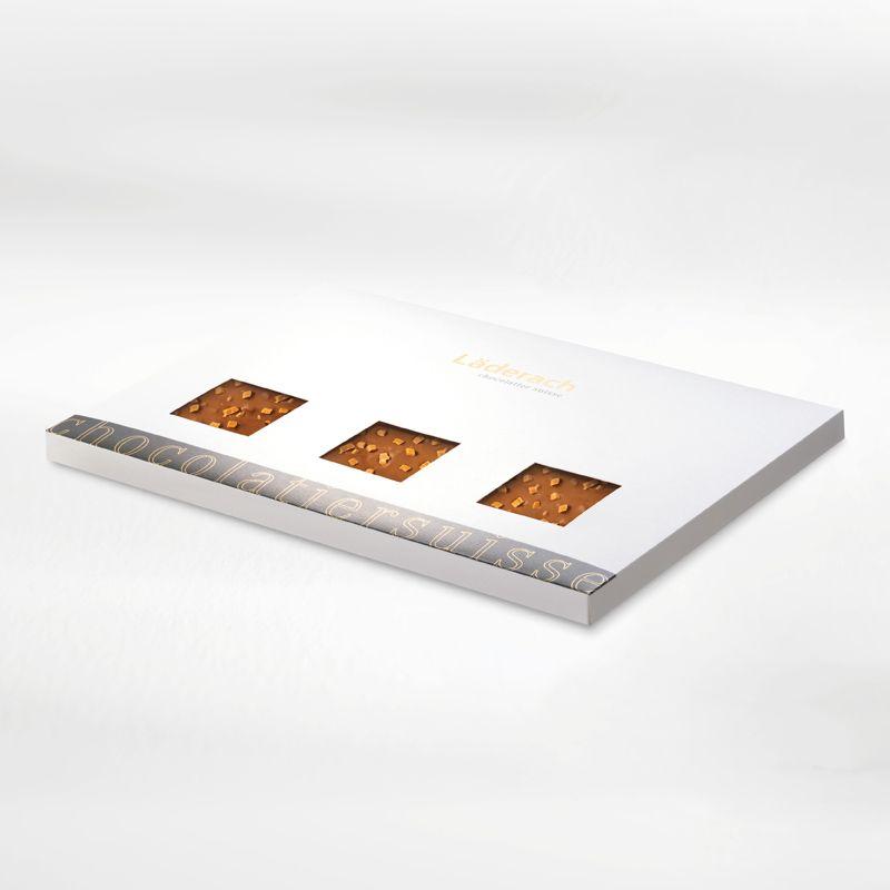 Шоколад молочный в коробке (с кусочками карамели) LADERACH, 700г
